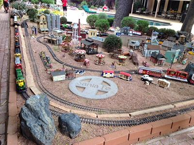 Expansive model train set in a backyard