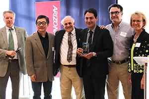 The MetOxs team accepts their I-Squared award