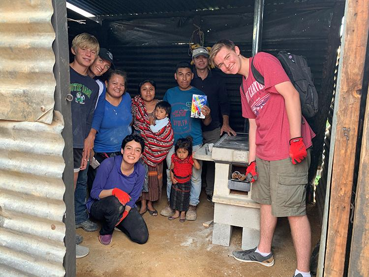 Kelly Stark and her family with a Guatamalan family in their home.