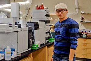Mojtaba Azadi Aghdam runs samples on a mass spectrometer in Shane Snyder's lab.