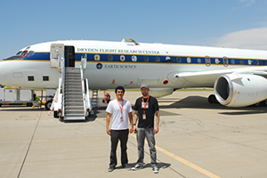 Researchers outside airplane