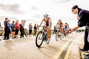 Erica Clevenger leading a pack of cyclists; photo by Jimmy Song Photography