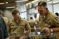 Professor of naval science and Colonel Patrick Wall, converses with ROTC member Alexander Heydt on Wednesday, Aug. 31. UA's special collections gave UA NROTC a special tour of the USS Arizona exhibit. Photo by Jesus Barrera/The Daily Wildcat