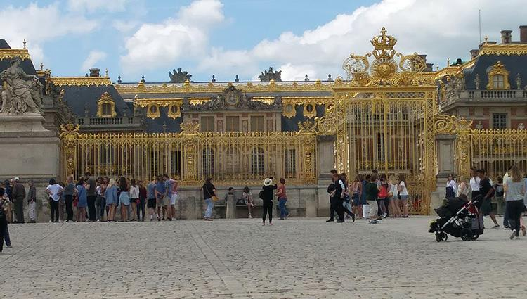 The gold-covered Palace of Versailles from the courtyard