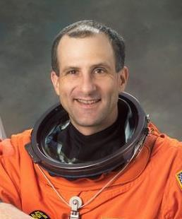 A man in an orange space suit