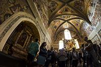 Study abroad students gaze at frescos alongside other visitors inside the Duomo di Orvieto in Orvieto, Italy, on May 27, 2016. Photo by Alex McIntyre/The Daily Wildcat