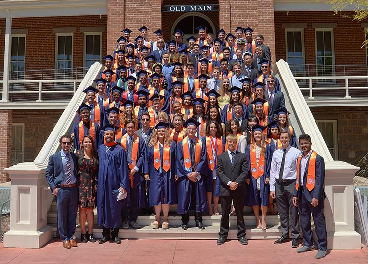 CHEE Class of 2019 on the steps of Old Main in caps and gowns