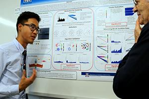 Wu discusses his research at a poster presentation; Image courtesy of the UA Undergraduate Biology Research Program